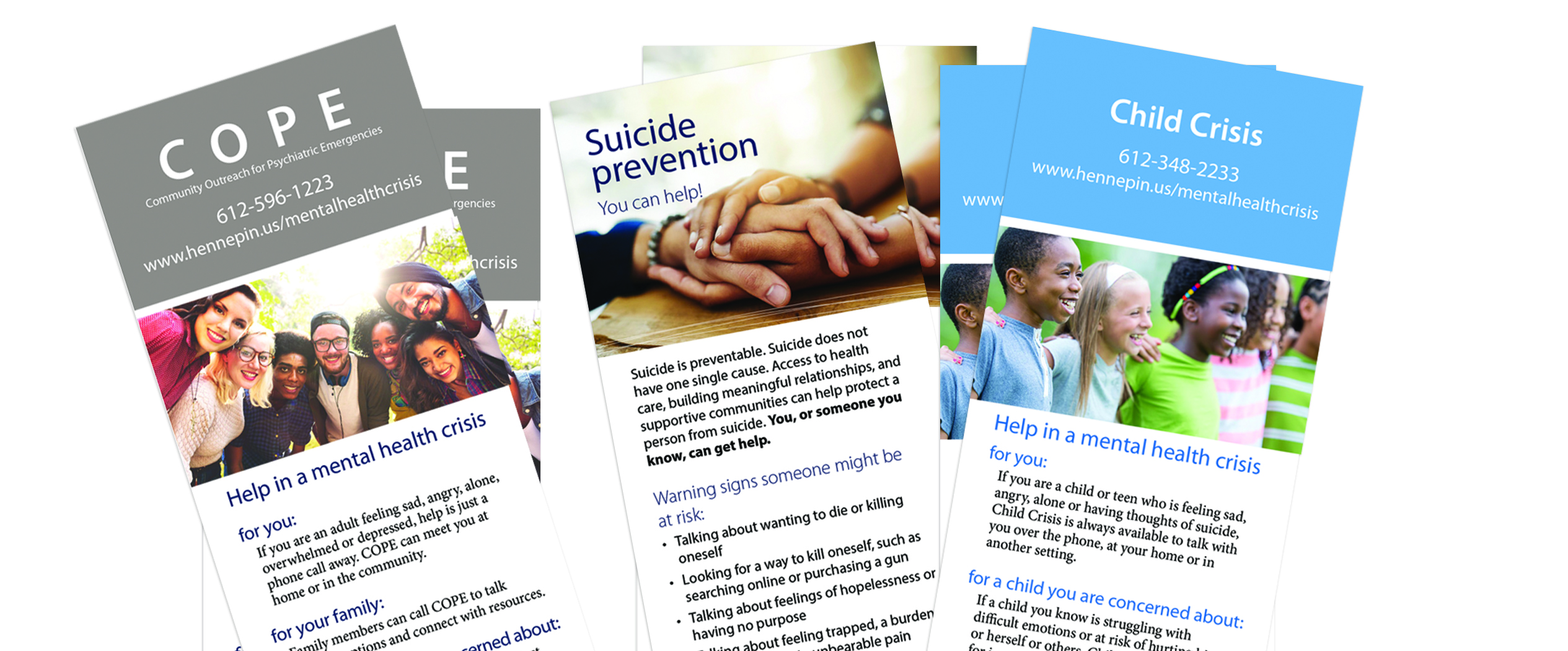 COPE, Child Crisis, and suicide prevention brochures sitting on a table