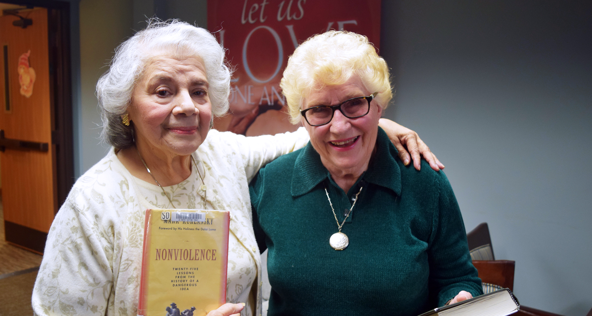 Carolyn and Nora receive library outreach services