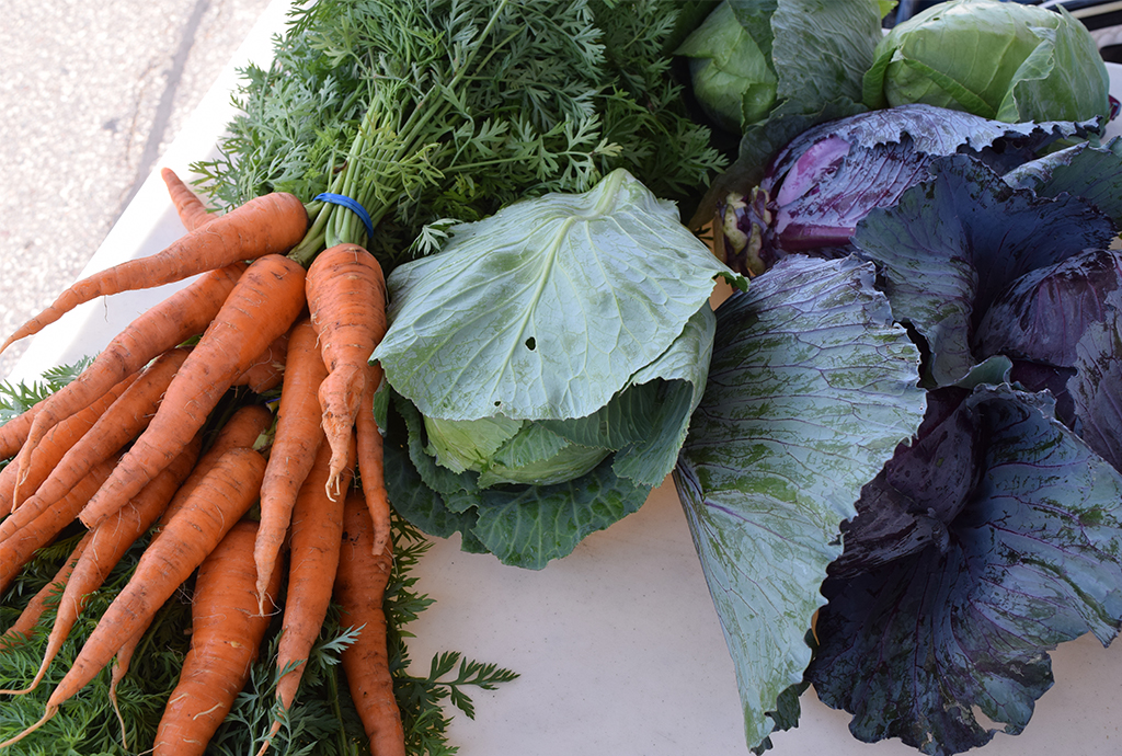 carrots and cabbage at the farmers market