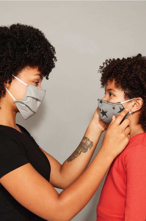 Two people wearing a mask